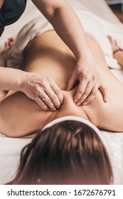 Post-traumatic rehabilitation with massage - a rehabilitation doctor performs a massage on the patient's back