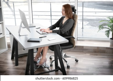 Posture concept. Young woman working with computer at office