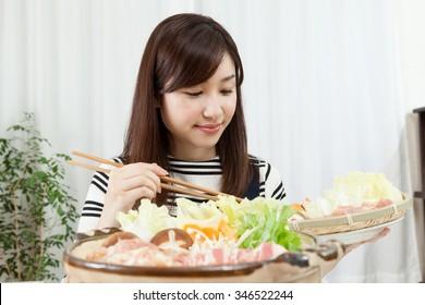 Pot cooking Japanese cuisine pot food party, Women smile appetite