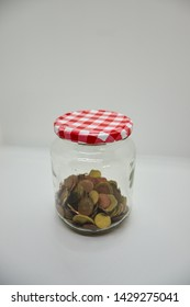 pot of euro coins with gray background