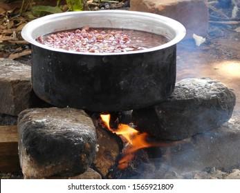 Pot of food cooking over open fire, Uganda, Africa