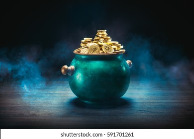 pot full of gold coins on a wooden surface and dark background / saint patricks day concept