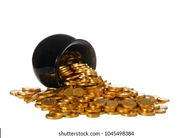 Pot of gold filled with gold coins spilling over onto white surface, isolated on white background. Fun Saint Patricks Day theme.