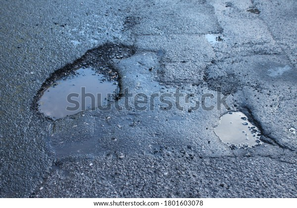 pot holes in asphalt road UK