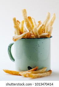 pot with hot and crispy fries