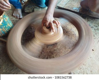 Pot or jug making in a traditional way of pottery System. Handcraft or hand pots and jugs making using clay and wheel