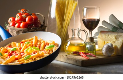 pot with macaroni and tomato sauce on the table