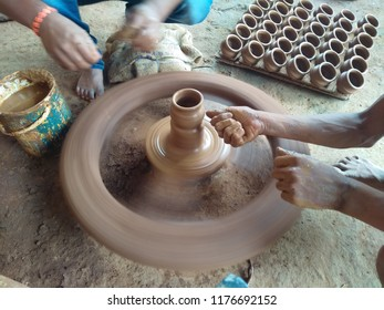 Pot making or shape giving in a wheel using hand