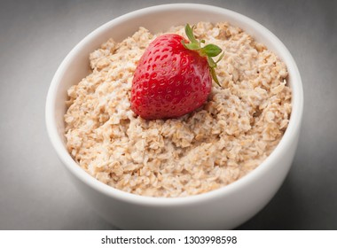 pot with oats, milk and strawberries to use in product packaging