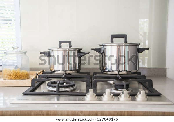 Pot On The Gas Stove And Cooking In Kitchen