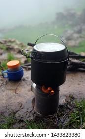 Pot on the tourist stovein mist