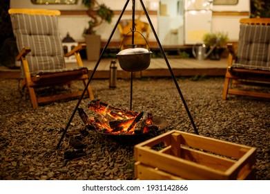 Pot is over campfire, picnic at camping, nobody