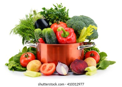 Pot and raw vegetables isolated on white background.