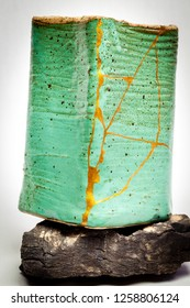 A pot repaired with the Japanese art form of kintsugi using urushi lacquer and gold powder.