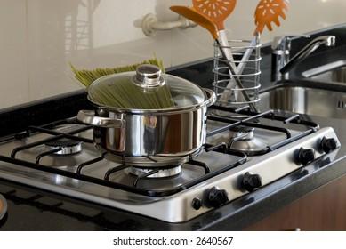 pot with spaghetti on kitchen surface
