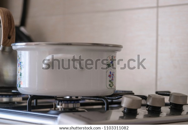 pot stands on a gas stove