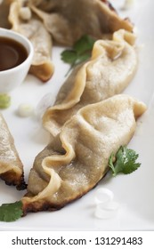 Pot stickers appetizer with orange soy sauce.