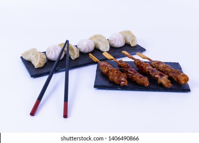 Pot Stickers and pork. Asian food. White background