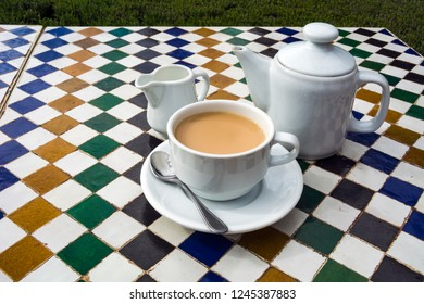 Pot of tea on ceramic tiled table in Moroccan cafe