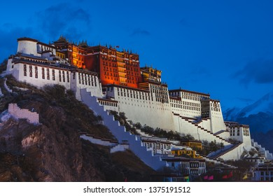Potala Palace in Lhasa, Tibet, lit up as evening approaches. Potala Palace is the seat of the Dalai Lama in Tibetan Buddhism.