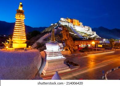Potala Palace and stupa at dusk in Lhasa, Tibet