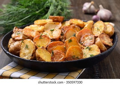 Potato baked with dill in pan, close up view.