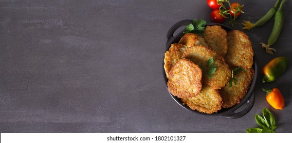 Potato Cakes. Vegetable fritters, latkes, draniki. Vegetable pancakes. View from above, top studio shot, copy space