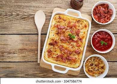 Potato casserole with parmesan cheese, cream and delicious fried bacon.top view