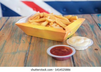 Potato chip french fries for takeaway in yellow box
