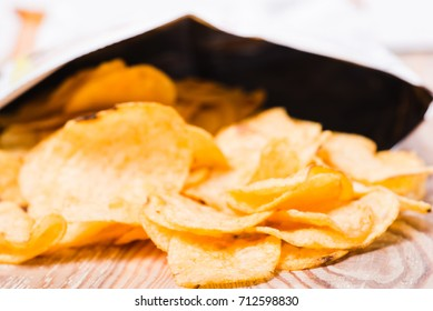 Potato chip heap, snack fried unhealthy fast food. Crunchy, delicious, tasty, salted, yellow, crispy, prepared lunch. Crisp spicy calorie meal slice pile.
