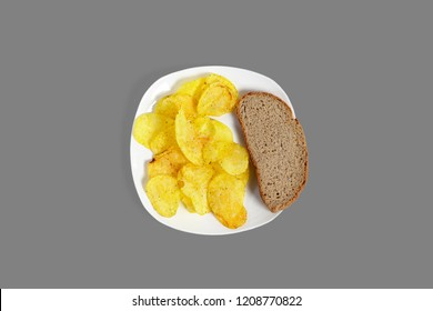 Potato chips and bread. Isolated on a gray background.