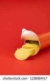 Potato chips in bright red background. Minimalistic image of attention grabbing snacks in vivid colors