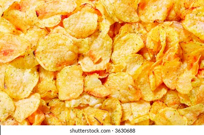 Potato chips close-up view from above, may be used as background