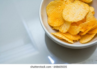 Potato chips in a cream-colored cup