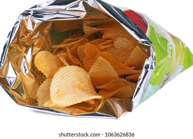 Potato chips, crisps in opened bag isolated in white background