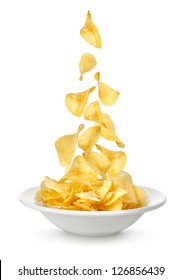 Potato chips falling in the plate. Isolated on white background