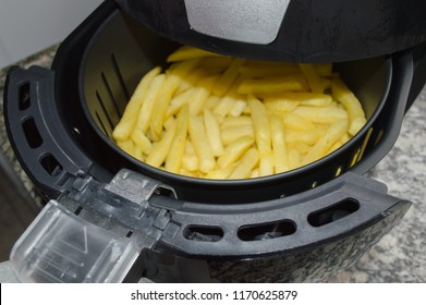 potato chips, French fries, being prepared in an oil-free fryer, Fryer without oil