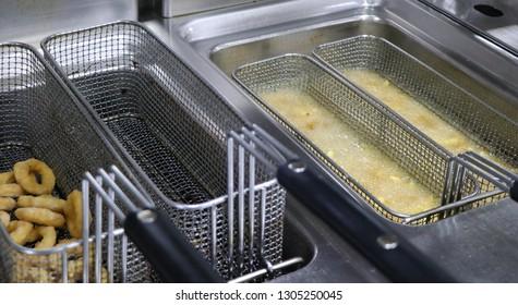 potato chips frying in a deep fryer
