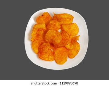 Potato chips on a white plate. Isolated on a gray background.