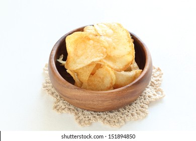 potato chips on wooden bowl