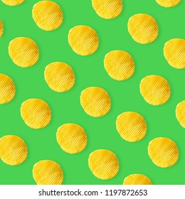Potato chips pattern on pastel green background top view flat lay