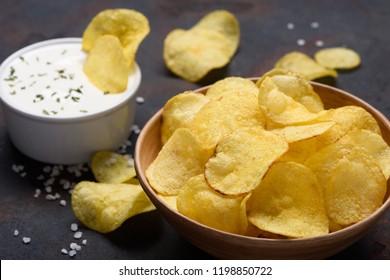 Potato chips with sauce dip and salt