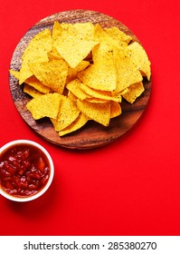 Potato chips with sauce on a red background