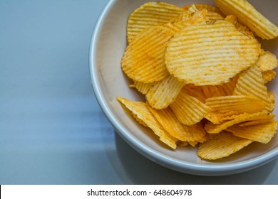 Potato chips is snake in cup on table
