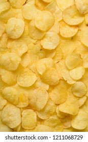 Potato chips texture background flat overhead view