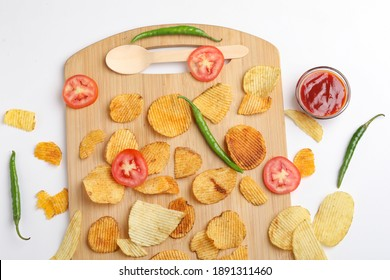 Potato chips with tomato ketchup isolated on white background