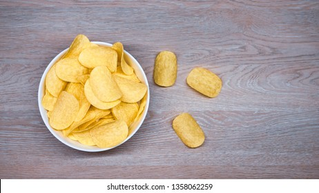 Potato chips in a white bowl, view from above