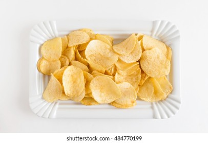 potato chips in a white dish isolated.