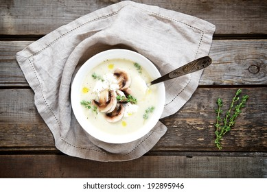 Potato cream soup with mushrooms, thyme and ricotta. Top view.