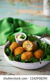potato croquettes with mortadella. style rustic. selective focus